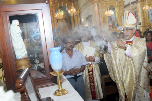 ARCHBISHOP   INCENSING THE STATUE AND RELIC OF MOTHER TERESA
